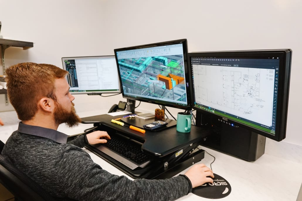 RWB employee at computer working on a building information model (BIM)